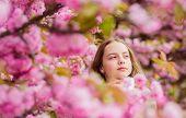Child Enjoy Warm Spring. Sniffing Flowers. Girl Enjoying Floral Aroma. Botany Concept. Kid Enjoying  poster