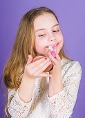 Promoting Healthy Lips Without Causing Dependency. Cute Small Child Applying Lip Care Stick. Adorabl poster
