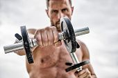 Healthy Mind In A Healthy Body. Muscular Man Exercising With Dumbbell. Dumbbell Exercise. Dare To Be poster