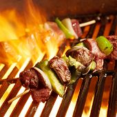 stock photo of barbecue grill  - beef shish kabobs on the grill - JPG