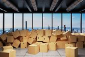 Large Industrial Urban Warehouse With Large Pile Of Cardboard Moving Boxes In Front Of Skyline, Conc poster