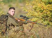 Hunting Equipment For Professionals. Hunting Is Brutal Masculine Hobby. Hunter Hold Rifle. Man Wear  poster