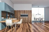 Wooden And Blue Kitchen Interior With Table poster