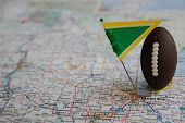 Macro Shot Of A Flag And Football Placed On Green Bay, Wisconsin In A Map. poster