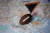 Macro Shot Of A Flag And Football Placed On New Orleans, Louisiana In A Map. poster