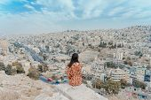 Young Woman Enjoying The View Of The City From Amman Citadel Or Jabal Al-qalaa, A Historic Site Fro poster
