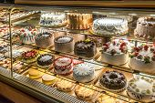stock photo of cheesecake  - Cakes on display in an Italian Bakery in Little Italy - JPG