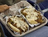 image of cheesesteak  - Enjoying a philly cheese steak at a sporting event - JPG