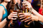 stock photo of alcoholic drinks  - Group of party people  - JPG