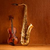 picture of sax  - Classic music Sax tenor saxophone violin  in vintage wood background - JPG