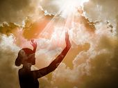stock photo of prayer  - young girl at sunset praise the lord - JPG