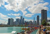 Tourists At Navy Pier And Cityscape Of Chicago, Illinois