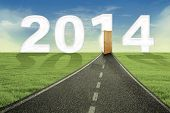 stock photo of new year 2014  - New future concept with the road and open door to new future in 2014 - JPG