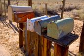stock photo of mailbox  - Mailboxes mail box aged vintage in west California desert - JPG