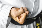 stock photo of fist  - Closeup of karate fighter making a fist - JPG