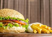 picture of hamburger  - Hamburger and french fries on the wooden board - JPG