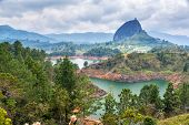 stock photo of medellin  - View of The Rock near the town of Guatape Antioquia in Colombia - JPG