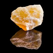 foto of calcite  - Calcite crystal with reflection on black surface background - JPG
