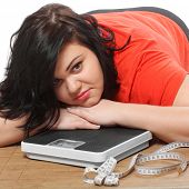stock photo of diabetes mellitus  - Overweight woman with a weighing machine and measure tape - JPG