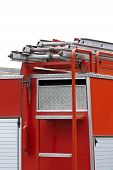 stock photo of ladder truck  - Back End Of A Fire Truck With A Ladder - JPG