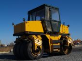 stock photo of oversize load  - The building technics works on the device of new road - JPG