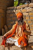 JAISALMER, INDIA - NOVEMBER 28, 2012: Indian sadhu (holy man) blessing. Sadhus are holy men who live