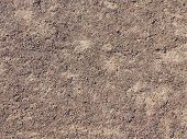 stock photo of floor covering  - fine texture of brown gravel on a dirt road - JPG