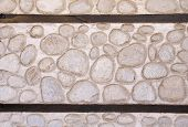 picture of gneiss  - Stone wall with two wooden beams closeup - JPG