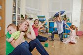 foto of upset  - female parent woman frustrated and upset from children behaviour - JPG