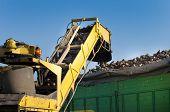 stock photo of sugar industry  - Combine harvester dumping sugar beets in trailer - JPG