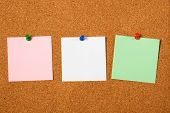 pic of bulletin board  - Three blank notes pinned on cork notice board - JPG