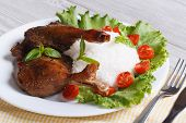 pic of roast duck  - roasted duck leg with rice and vegetables on the plate closeup horizontal - JPG