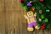 foto of gingerbread man  - traditional Christmas gingerbread man with festive decorations and Christmas tree - JPG