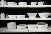 foto of crockery  - White crockery on shelves at a shop - JPG