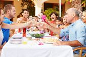 stock photo of grandparent child  - Large Family Group Celebrating Birthday On Terrace Together - JPG