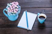 foto of pencils  - Cup of coffee with notebook and pencil on wooden table - JPG