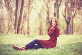 picture of redheaded  - Beautiful redhead women in the park in spring time - JPG