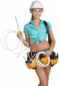 image of coil  - Woman wearing hard hat and tool belt - JPG