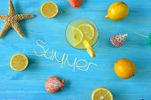 stock photo of starfish  - Fresh lemonade with starfish and seashells on blue table - JPG