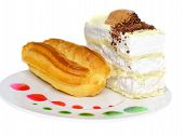 stock photo of eclairs  - Sponge cakes and eclair cake on plate with fruit juice spots - JPG