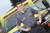 picture of paramedic  - Paramedic employee with ambulance in the background - JPG