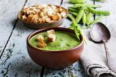 image of pea  - puree soup with green peas on a wooden surface - JPG
