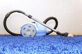 picture of laminate  - The metal pipe of vacuum cleaner in action  - JPG