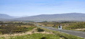picture of boggy  - road signs on the road crossing boggy rannoch moor in the highlands of scotland - JPG