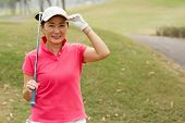 image of ladies golf  - Happy lady golfer on the golf course - JPG