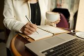 picture of coffee crop  - Cropped image of business lady drinking coffee and planning her day - JPG