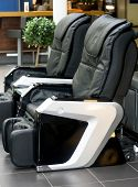 pic of comfort  - Two black electric leather comfortable massage chairs - JPG