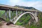 image of bridges  - Rocky Creek Bridge historic bridge 1932 near Big Sur California green mountain old bridge in highway 1 California Coastline - JPG