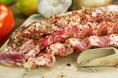 pic of souse  - Raw Spare Ribs On Wood Cutting Board With Spices And Vegetables Close - JPG