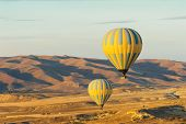 foto of goreme  - Hot air balloons flying over Cappadocia near Goreme at sunrise - JPG